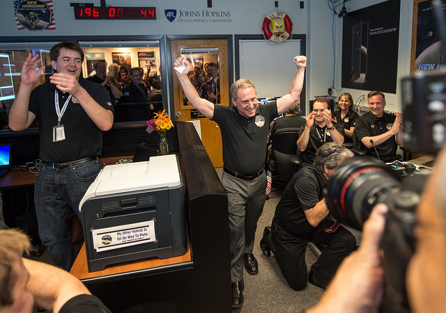 New Horizons principal investigator Alan Stern celebrates the reception of the first signals from New Horizons after a historic encounter with faraway Pluto. Credit: NASA/Bill Ingalls
