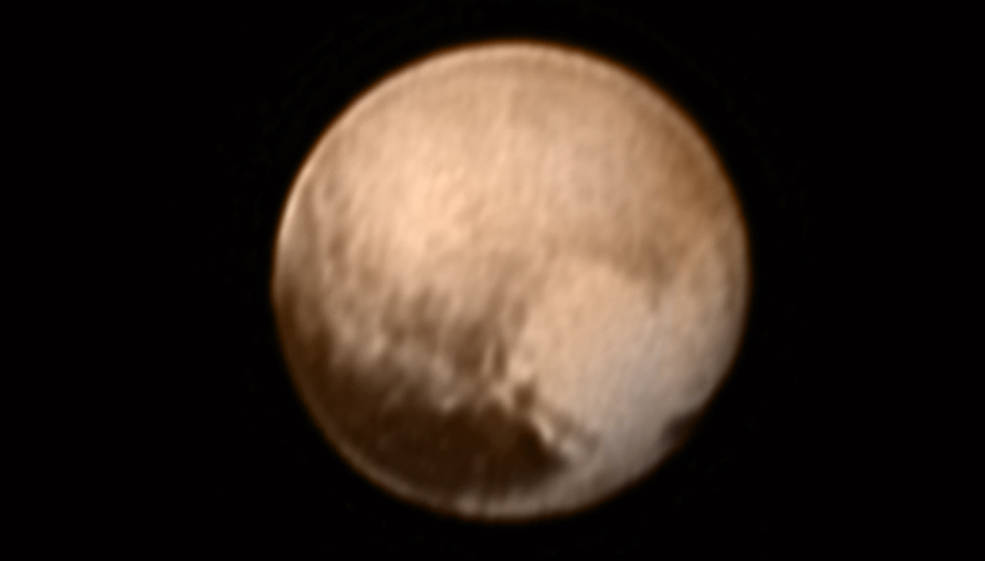 This image of Pluto from New Horizons' Long Range Reconnaissance Imager (LORRI) was received on July 8, and has been combined with lower-resolution color information from the Ralph instrument. Credit: NASA/JHUAPL/SWRI