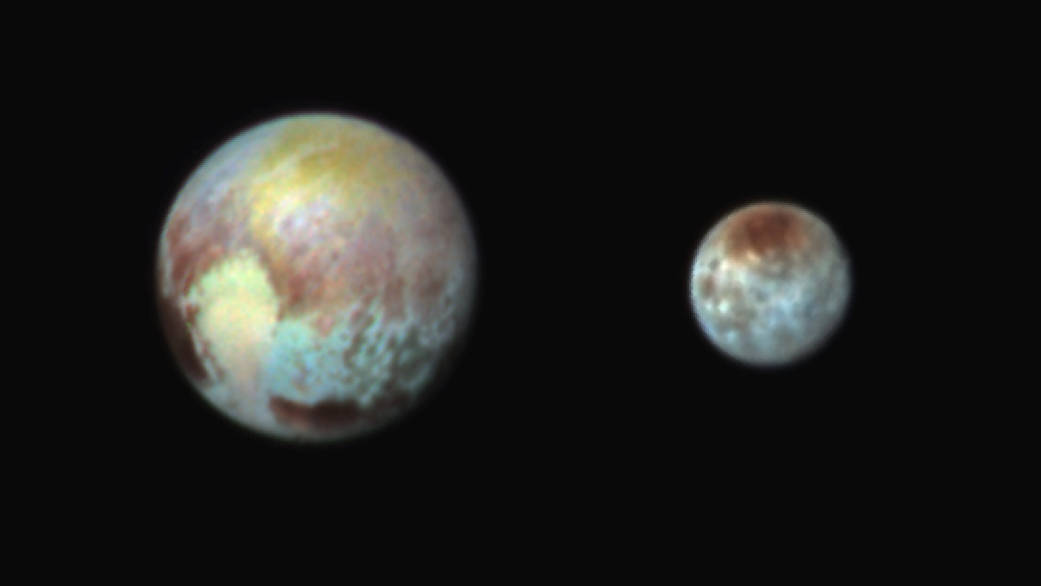 This July 13, 2015, image of Pluto and Charon is presented in false colors to make differences in surface material and features easy to see. It was obtained by the Ralph instrument on NASA's New Horizons spacecraft, using three filters to obtain color information, which is exaggerated in the image.  These are not the actual colors of Pluto and Charon, and the apparent distance between the two bodies has been reduced for this side-by-side view. Credit: NASA/JHUAPL/SWRI