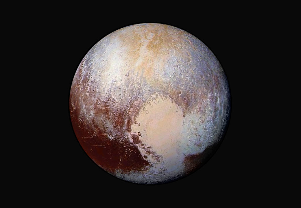 This global mosaic of Pluto uses exaggerated colors to illustrate contrasts between different geologic units. The differences in the two lobes of the heart, or Tombaugh Regio, are obvious in this image. Credit: NASA/JHUAPL/SWRI