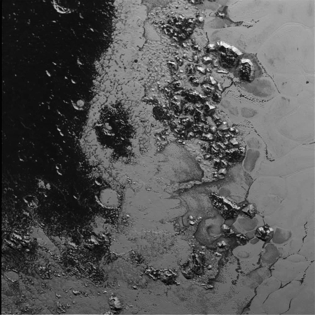 The Hillary Montes mountain range, seen here in the upper right, is surrounded by an ice sheet, which tapers into much darker, older terrain at left in a region called Cthulhu Regio. Credit: NASA/JHUAPL/SWRI
