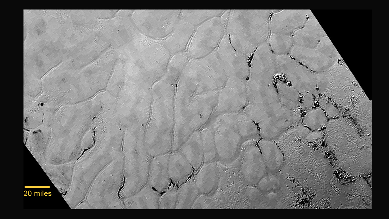 This week's New Horizons flyby of Pluto revealed unexpected terrain, such as these blocky patches of ice at a region dubbed Sputnik Planum. New Horizons' LORRI camera took this image from a distance of 48,000 miles (77,00 kilometers) on July 14. The resolution is about 1 kilometer (0.6 miles). Credit: NASA/JHUAPL/SWRI
