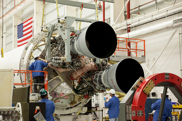 Technicians connect two new RD-181 engines to the Antares rocket's first stage at Wallops Island, Virginia. Credit: Orbital ATK