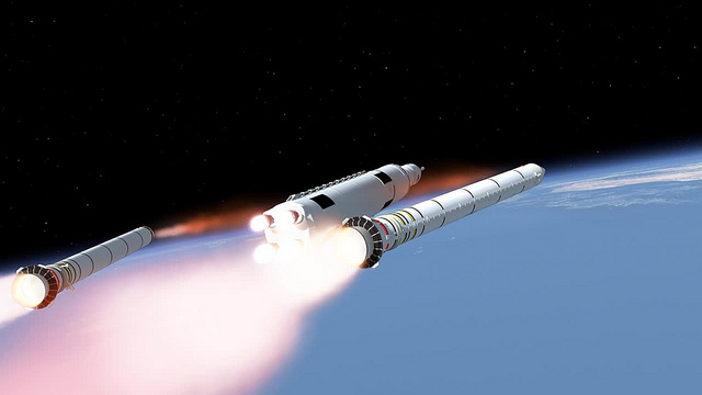 Artist's concept of the Space Launch System, showing its two solid rocket boosters jettisoned from the core stage, which is powered by four RS-25 main engines. Credit: NASA