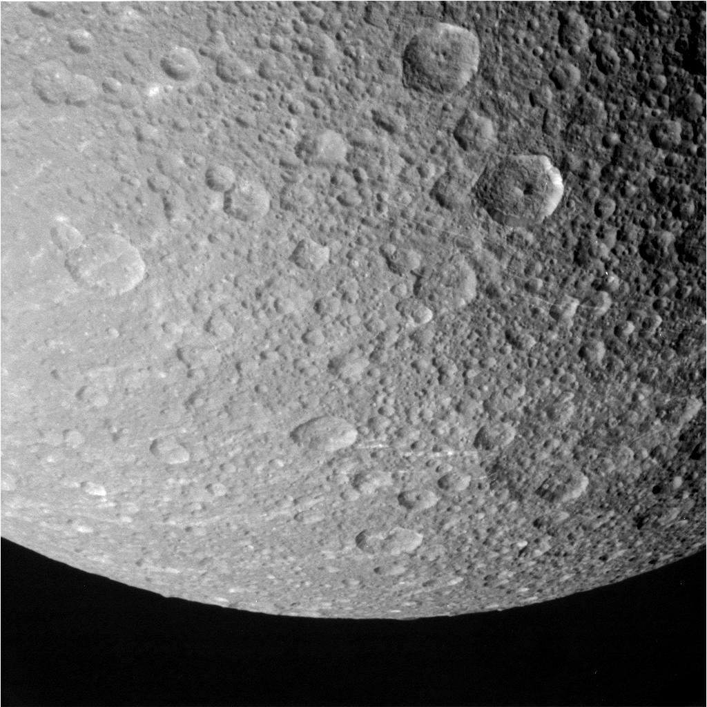 This raw image of Dione was captured during Cassini's encounter Monday. Credit: NASA/JPL-Caltech/Space Science Institute