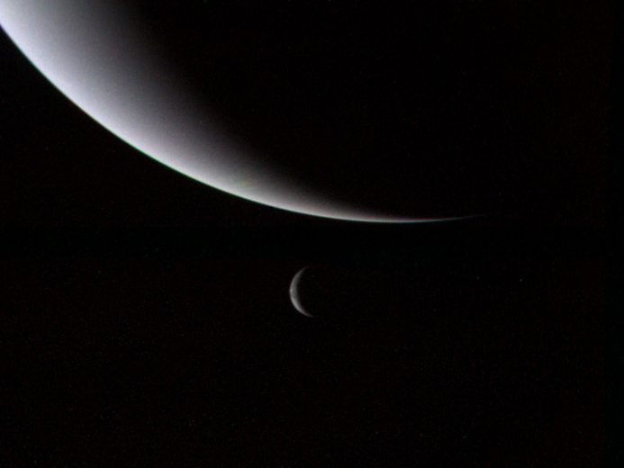 Neptune and its largest moon Triton are pictured in this view from NASA's Voyager 2 mission in 1989. Credit: NASA