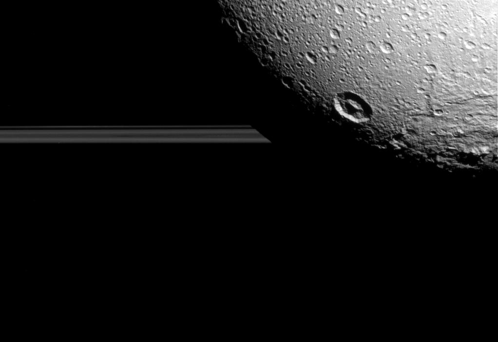 Dione eclipses one of Saturn's rings. Credit: NASA/JPL-Caltech/Space Science Institute