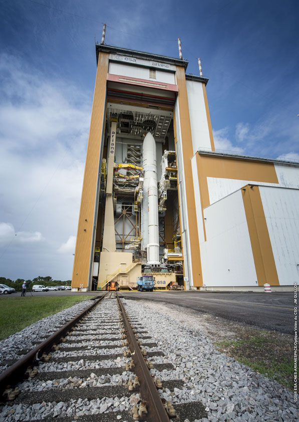 The 179-foot-tall Ariane 5 rocket prepares to depart the final assembly building at the Guiana Space Center. Credit: ESA/CNES/Arianespace – Optique Video du CSG – JM Guillon