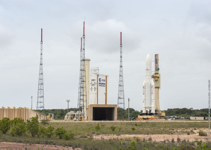 An Ariane 5 rocket reaches the ELA-3 launch zone in Kourou, French Guiana, during rollout Wednesday. Credit: ESA/CNES/Arianespace – Optique Video du CSG – JM Guillon