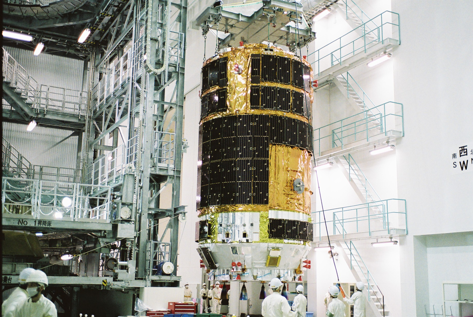 Japanese technicians prepare the fifth H-2 Transfer Vehicle for launch at the Tanegashima Space Center in Japan. Credit: JAXA