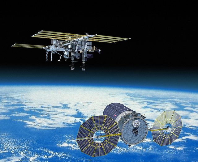Artist's concept of an enhanced Cygnus approaching the International Space Station. Credit: Orbital ATK