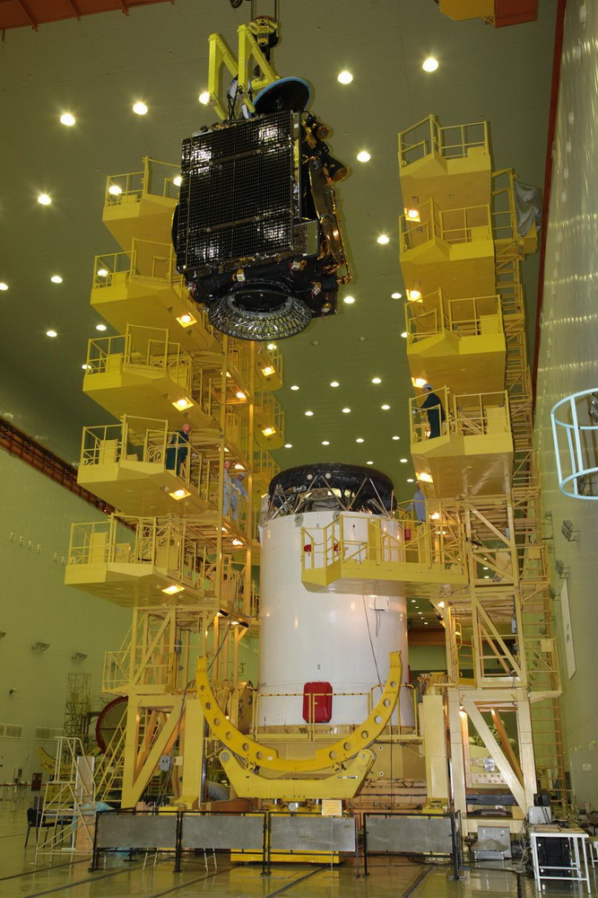 The Express AM8 satellite, seen here being lifted atop its Block DM upper stage, will provide communications services across an area stretching from the Americas to Russia. Credit: TsENKI
