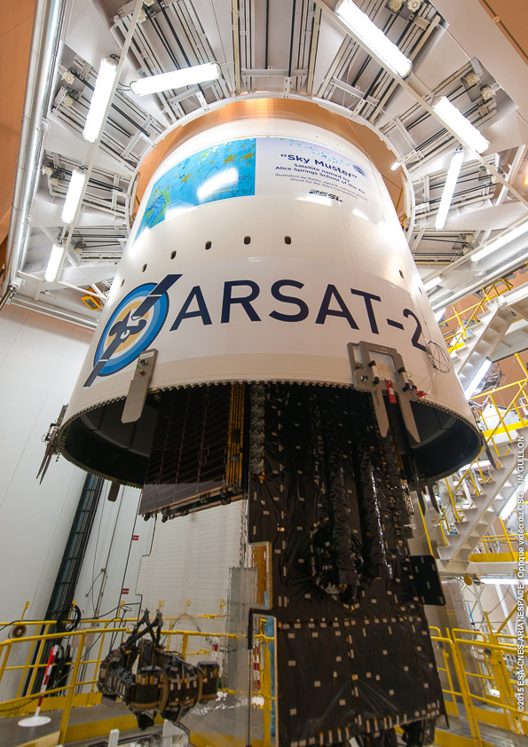 The Ariane 5's payload fairing is lowered over the Sky Muster satellite during launch preparations at the Guiana Space Center. Credit: Credit: ESA/CNES/Arianespace – Photo Optique Video du CSG – JM Guillon