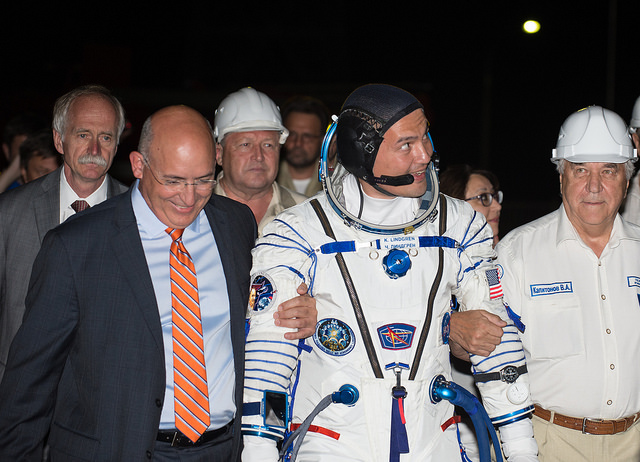 Suffredini (left) escorts NASA astronaut Kjell Lindgren to the Soyuz launch pad at the Baikonur Cosmodrome before a launch in July. Credit: NASA/Aubrey Gemignani