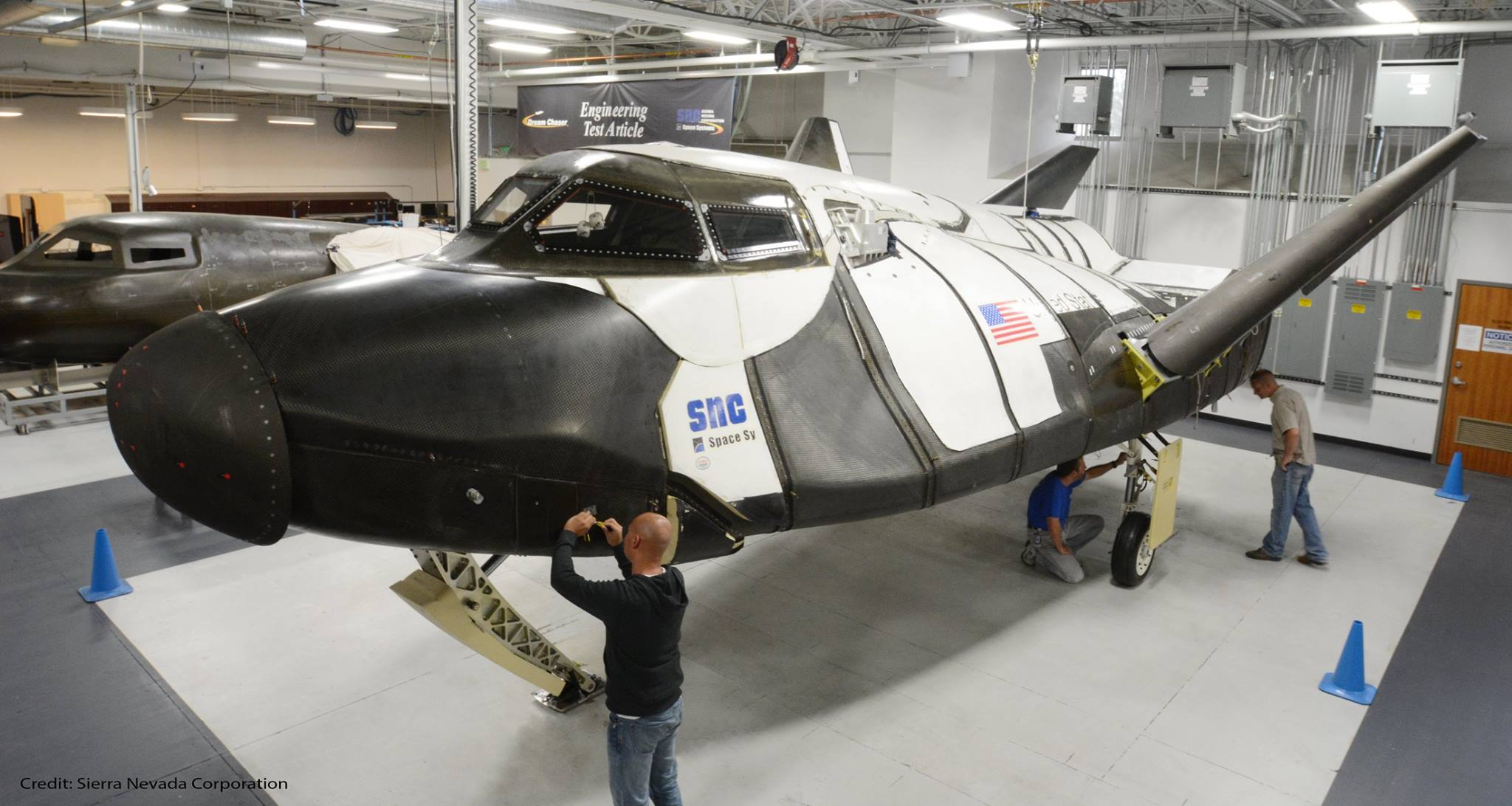 Sierra Nevada Corp. technicians prepare the Dream Chaser engineering test article for another round of atmospheric flight tests. Credit: Sierra Nevada