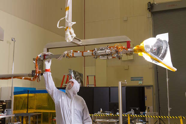 OSIRIS-REx's sample collection arm is tested inside Lockheed Martin's factory near Denver in this picture shared on the blog of Dante Lauretta, the mission's principal investigator. Credit: Dante Lauretta
