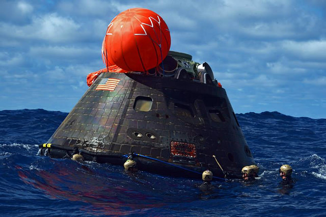 The Orion spacecraft completed its first orbital test flight in December 2014. The capsule is seen here after splashdown in the Pacific Ocean. Credit: U.S. Navy Photo by Mass Communication Specialist 1st Class Corey Green