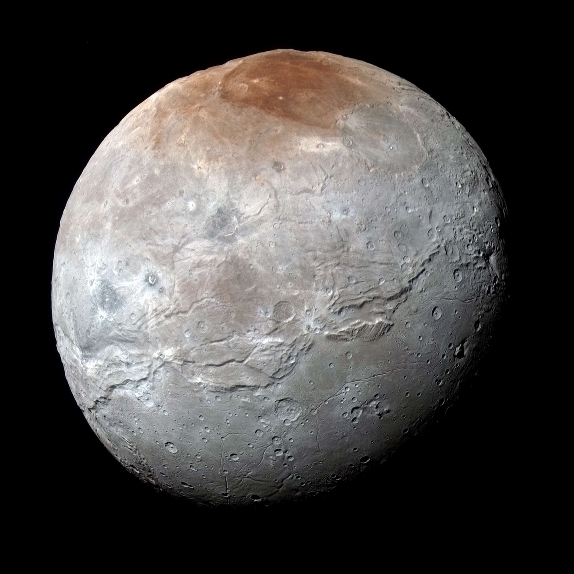 This enhanced color view of Charon comes from New Horizons' Ralph color camera. The colors highlight the subtle variations in the composition of Charon's crust, with the reddish region near the north pole -- informally named Mordor Macular -- standing out most prominently. Credit: NASA/Johns Hopkins University Applied Physics Laboratory/Southwest Research Institute