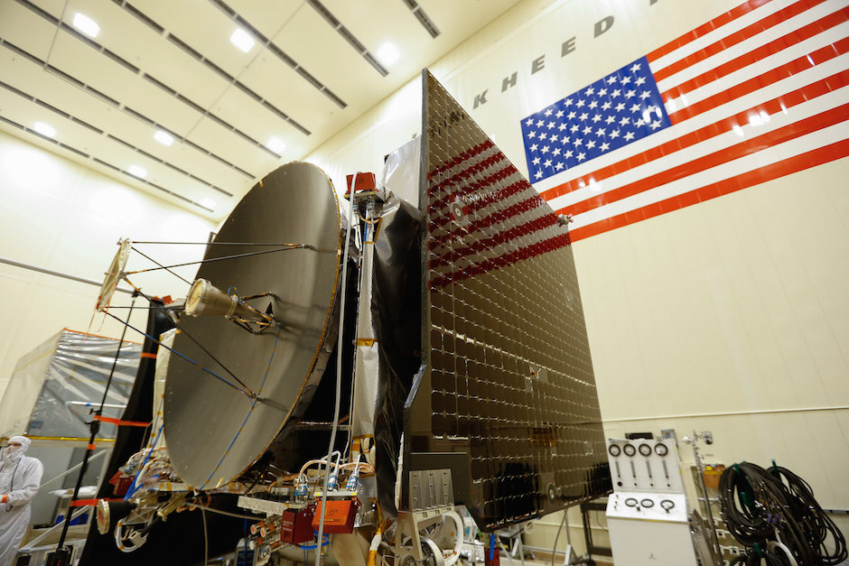 Technicians recently installed OSIRIS-REx's solar panels and high-gain antenna. Credit: Lockheed Martin