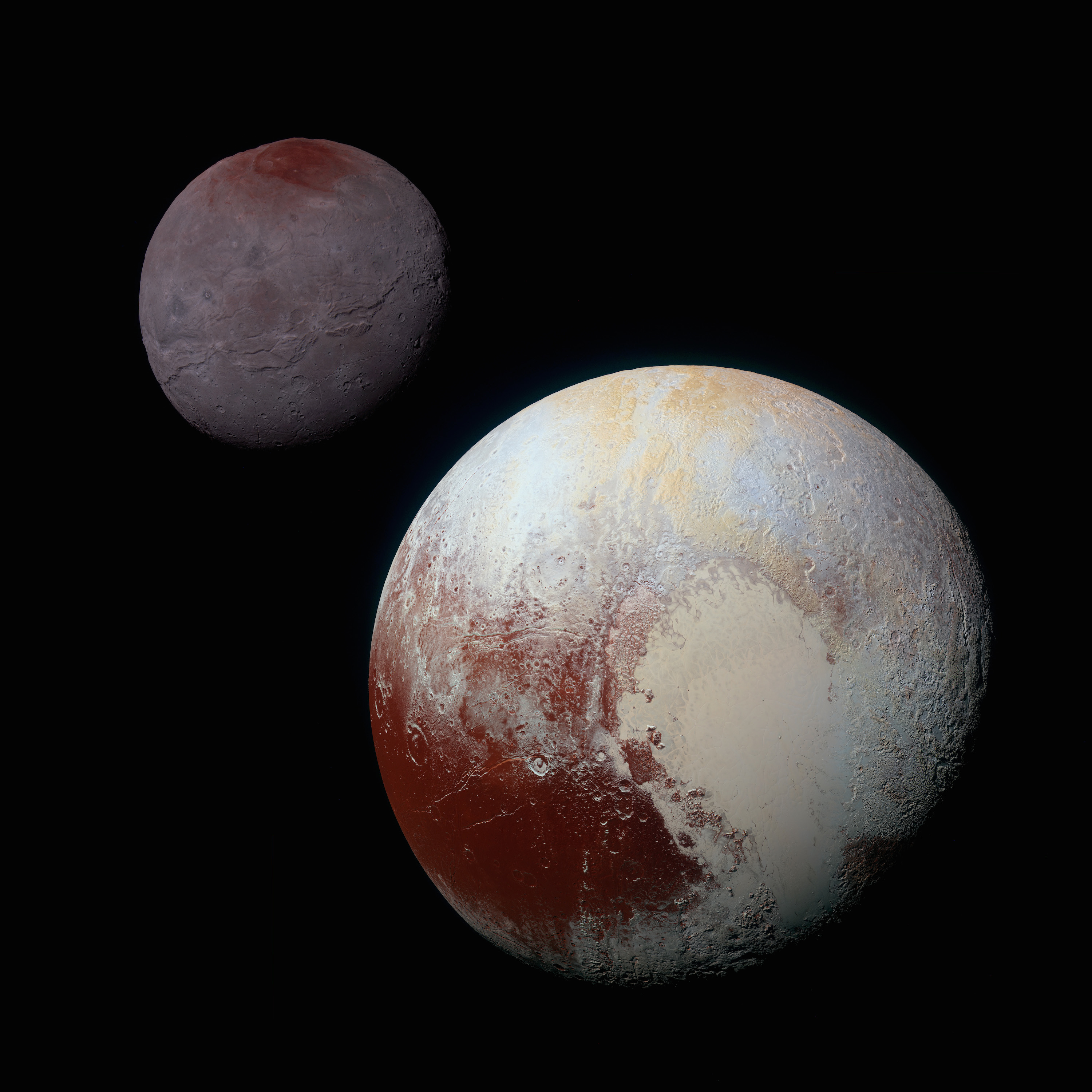 This composite image of Pluto and Charon with enhanced colors shows a direct comparison of the brightness and terrain types, highlighting the similarity between Charon's reddish north pole and red colors on Pluto. The separation between the two worlds is not to scale. Credit: NASA/Johns Hopkins University Applied Physics Laboratory/Southwest Research Institute