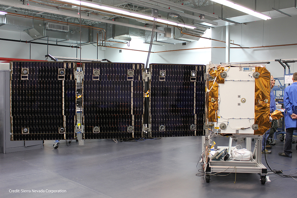 One of Orbcomm's OG2 data relay satellites is pictured inside its factory at Sierra Nevada Corp. in Louisville, Colorado. Credit: Sierra Nevada Corp.