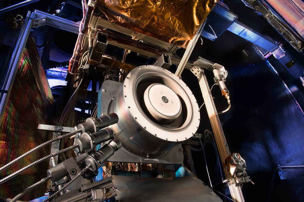 A high-power Hall thruster is seen inside a test chamber at NASA's Glenn Research Center. Credit: NASA