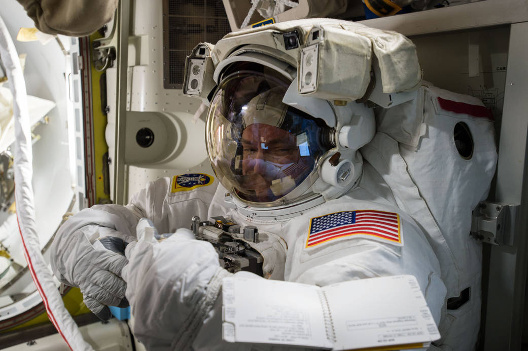 Scott Kelly tries on his spacesuit during preparations for Wednesday's spacewalk. Credit: NASA