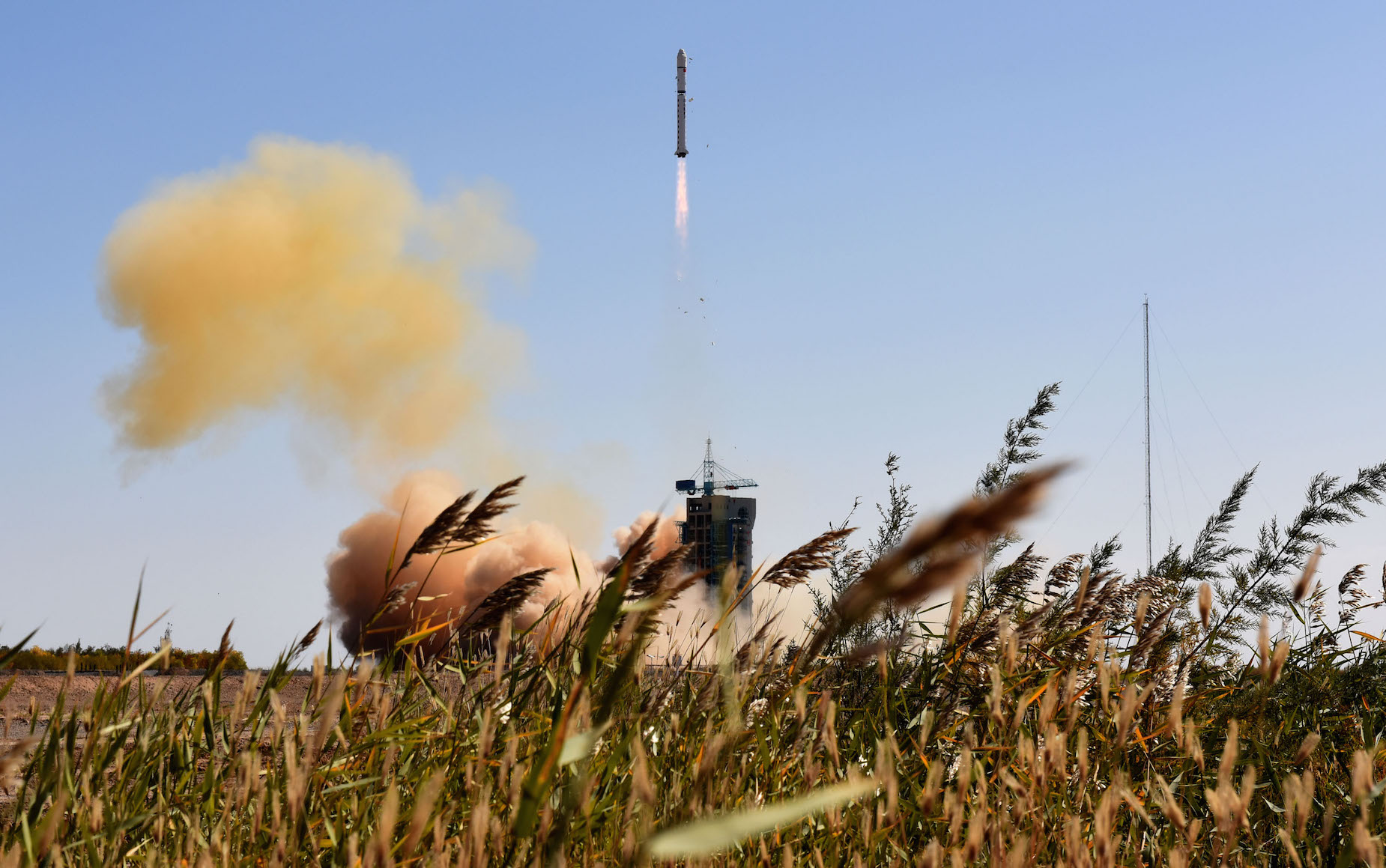 The Long March 2D rocket with four Jilin 1 satellites lifted off at 0413 GMT (12:13 a.m. EDT; 12:13 p.m. Beijing time) Wednesday. Credit: Xinhua