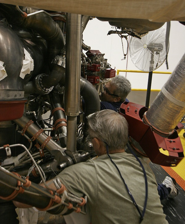 Aerojet Rocketdyne technicians work on an RS-25 engine at the company's facility at NASA's Stennis Space Center in Mississippi. Credit: Stephen Clark/Spaceflight Now