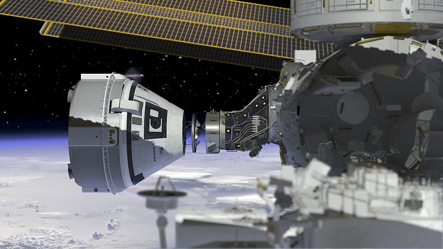 Artist's concept of Boeing's CST-100 Starliner crew capsule docking with the International Space Station. Credit: NASA