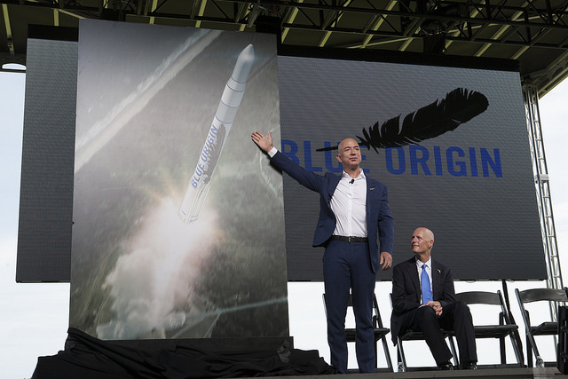 Jeff Bezos gives a sneak peek at Blue Origin's orbital launch vehicle in a September ceremony at Cape Canaveral Air Force Station. Credit: NASA/Kim Shiflett