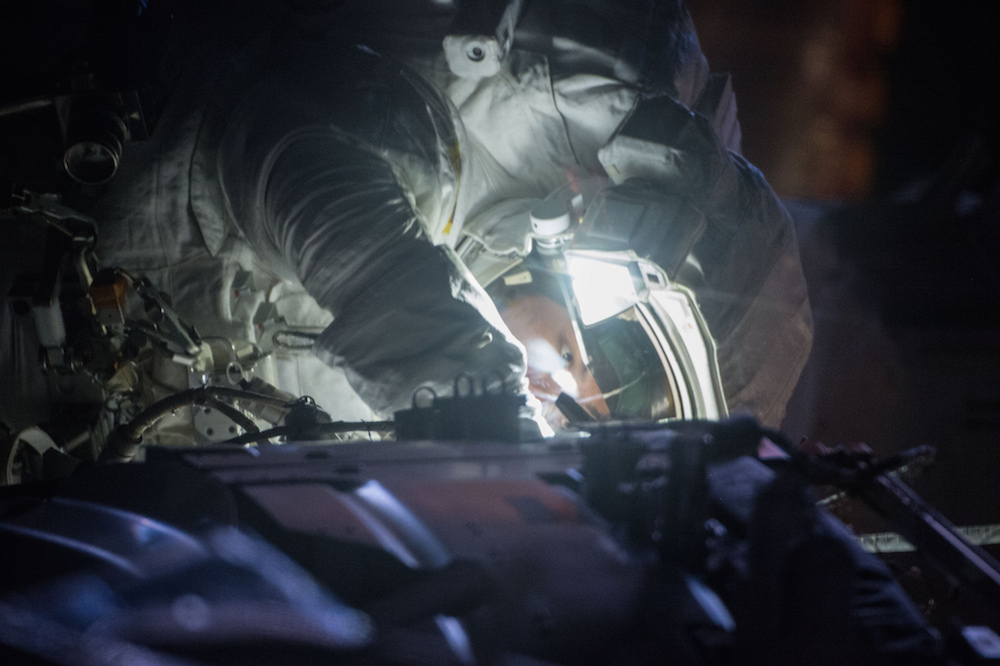 Astronaut Kjell Lindgren works on a night pass during an Oct. 28 spacewalk. Credit: NASA