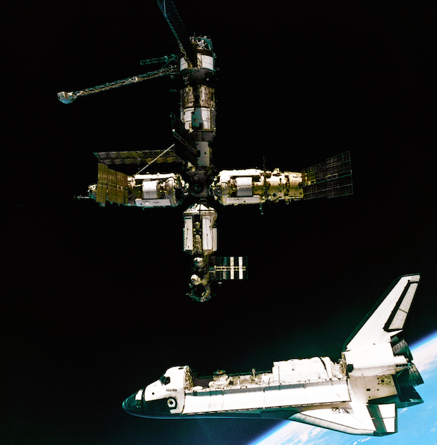 Russian cosmonauts aboard a Soyuz spacecraft captured this view of the shuttle Atlantis departs the Russian space station Mir on the STS-71 mission in 1995. Credit: NASA