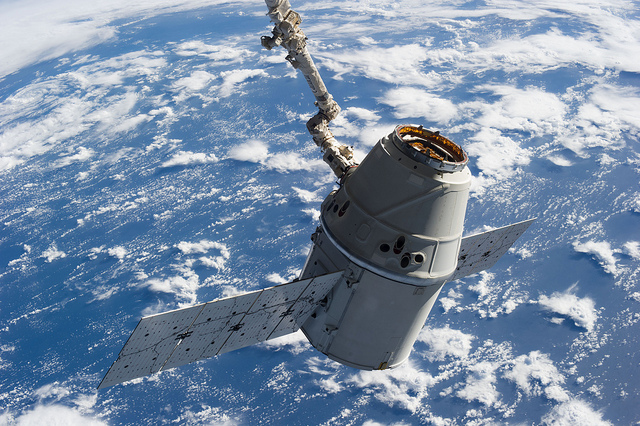 A SpaceX Dragon cargo craft is seen grappled by the International Space Station's robotic arm. Credit: NASA