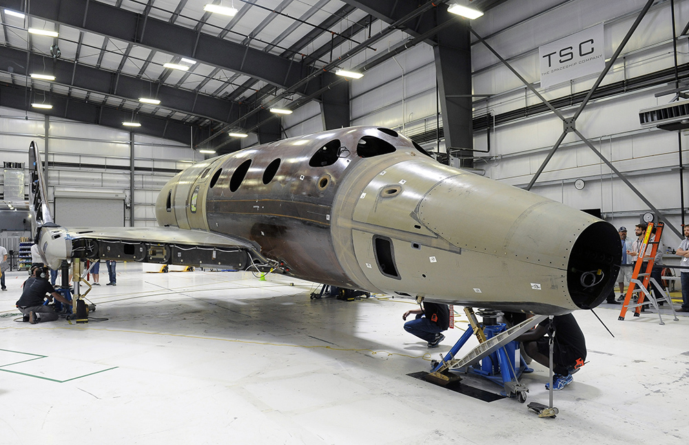 "Virgin Galactic's second SpaceShipTwo vehicle goes ""weight on wheels"" in Mojave in May. Credit: Virgin Galactic"