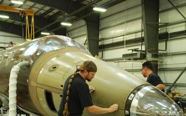 Technicians install SpaceShipTwo's forward pressuring tank. Credit: Virgin Galactic