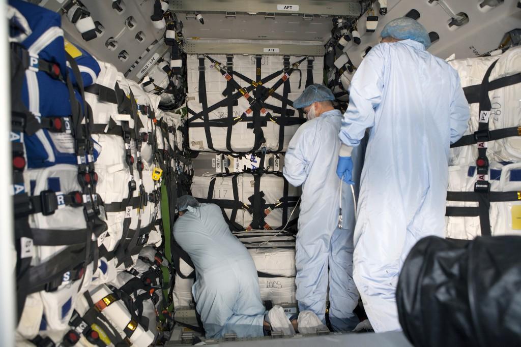 Technicians load Cygnus for launch. Credit: NASA-KSC