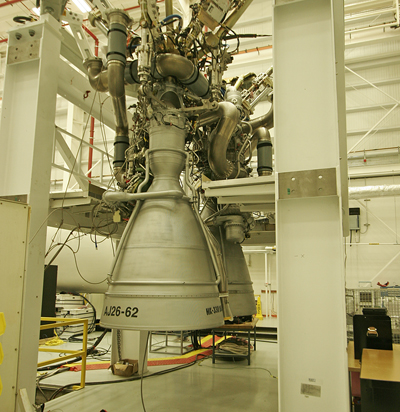 Two AJ26 engines are pictured integrated on their thrust frame before attachment to the base of an Antares first stage. Credit: Stephen Clark/Spaceflight Now