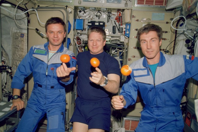 Expedition 1 commander Bill Shepherd, a former Navy SEAL, is flanked by Russian cosmonauts Yuri Gidzenko (left) and Sergei Krikalev (right) aboard the International Space Station in December 2000. Credit: NASA