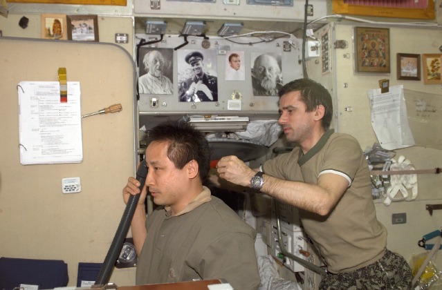 NASA astronaut Ed Lu (left) and Russian cosmonaut Yuri Malenchenko aboard the space station in 2003. Two-person crews lived on the station while the space shuttle was grounded in the wake of the Columbia accident. Credit: NASA