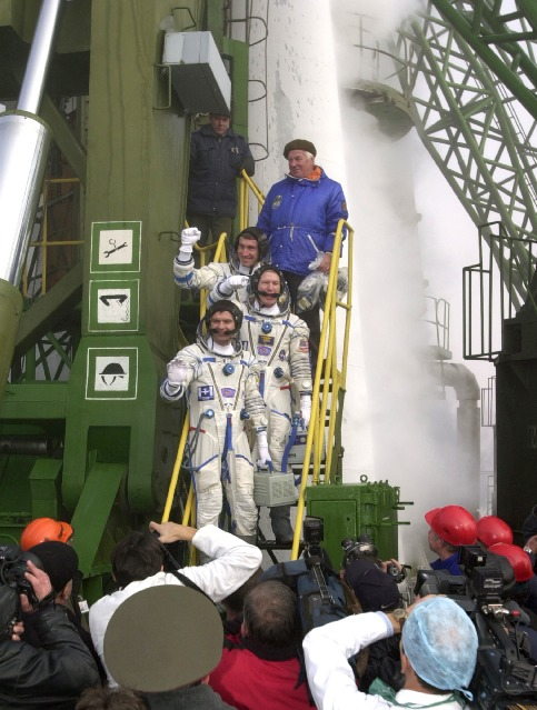 """Get those shuttles ready!"" yelled Shepherd moments before boarding Expedition 1's Soyuz spacecraft at Baikonur, alluding to the arduous in-orbit assembly task ahead involving dozens of space shuttle flights. Credit: NASA"
