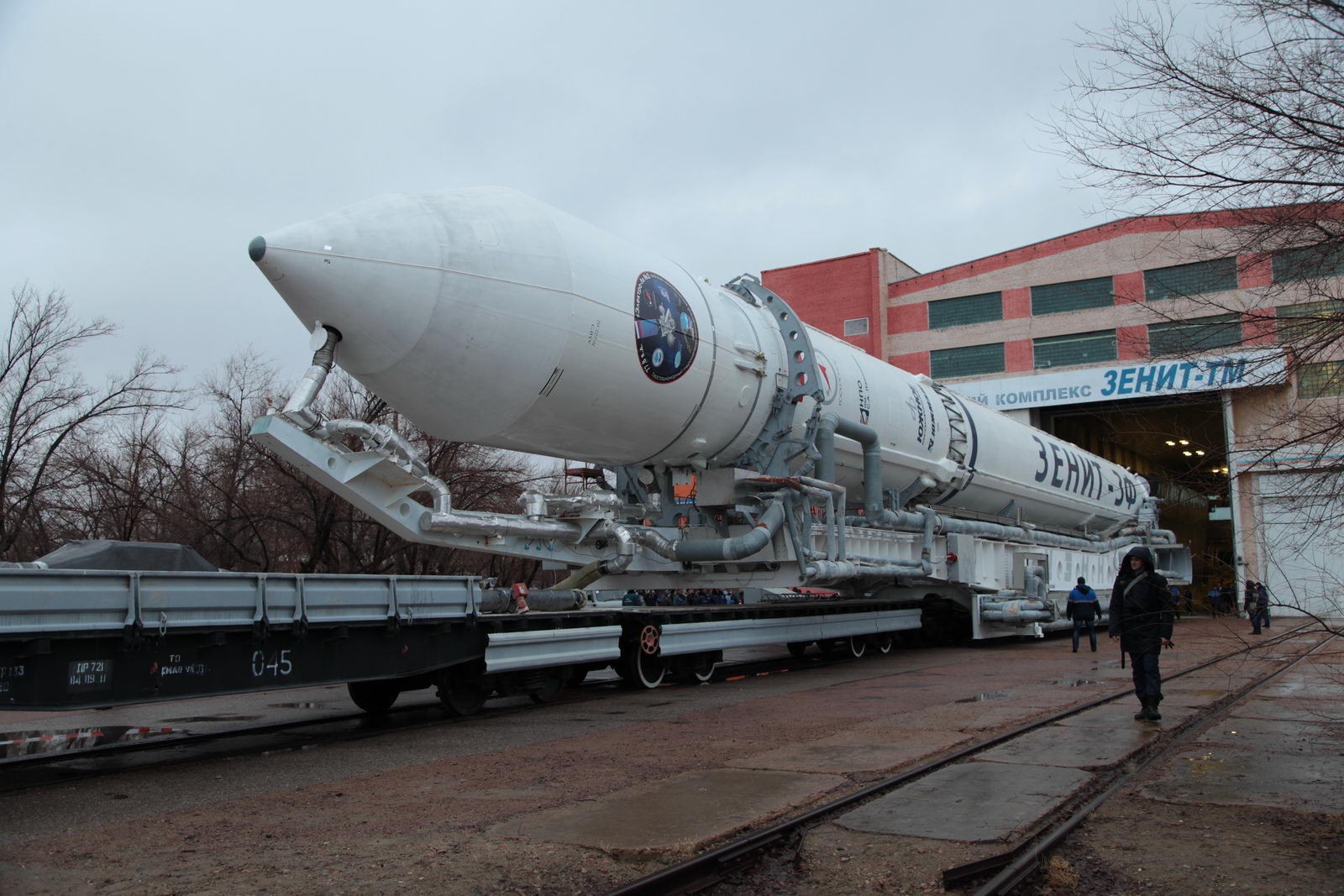 The Zenit rocket emerges from an assembly building at the Baikonur Cosmodrome on Wednesday for rollout to the launch pad. Credit: Roscosmos