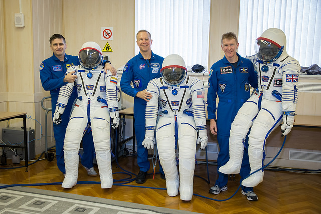 Veteran Russian cosmonaut Yuri Malenchenko, NASA astronaut Tim Kopra and European Space Agency astronaut Tim Peake pose with their Sokol spacesuits during launch preparations at the Baikonur Cosmodrome in Kazakhstan. Credit: NASA/Victor Zelentsov