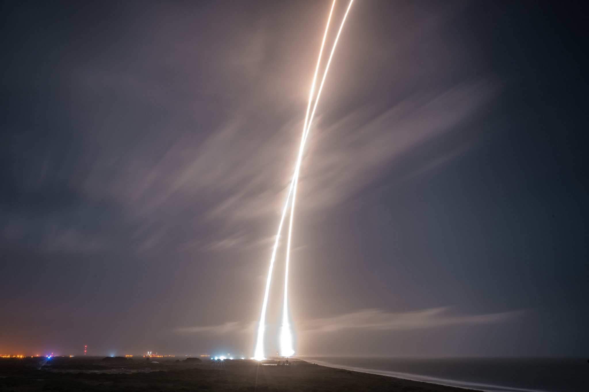 The Falcon 9's ascent and descent tracks are seen in this long exposure photo taken just south of the launch and landing locations. Photo credit: SpaceX