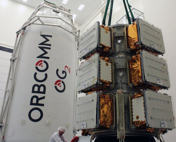 Orbcomm's 11 satellites aboard the Falcon 9 rocket are seen here before encapsulation inside the payload fairing. Credit: Orbcomm/SpaceX