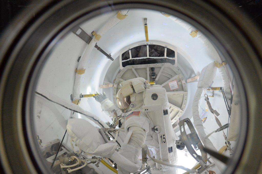 European Space Agency astronaut Tim Peake tweeted this photo of one of the spacewalkers inside the space station's Quest airlock. Credit: NASA/ESA/Tim Peake