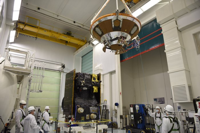 Technicians attach the ExoMars 2016 mission's Schiaparelli landing probe to the Trace Gas Orbiter ahead of a final set of ground tests at the Thales Alenia Space factory in Cannes, France. Credit: ESA/S. Corvaja