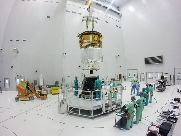 Ground crews lift LISA Pathfinder, and its propulsion module, atop the Vega rocket's payload adapter during launch preparations at the Guiana Space Center in South America. Credit: ESA–Manuel Pedoussaut, 2015