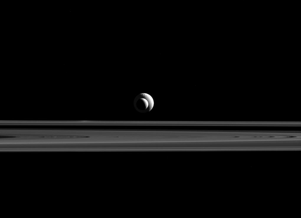 Like a cosmic bull's-eye, Enceladus and Tethys line up almost perfectly for Cassini's cameras. Credit: NASA/JPL-Caltech/Space Science Institute
