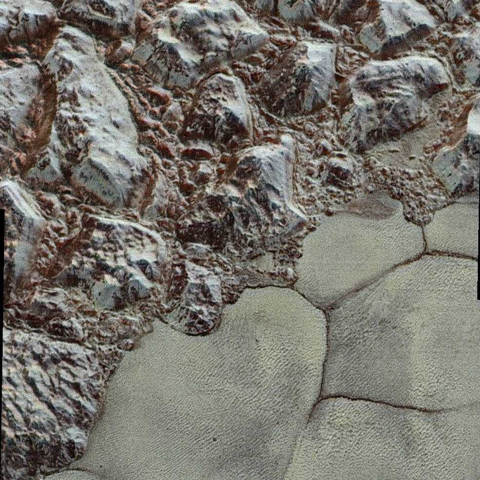 A cosmic shoreline is pictured here, where the vast icy plain informally named Sputnik Planum borders rugged mountains made of water ice blocks standing up to 1.5 miles (2.5 kilometers) tall. Credit: NASA/Johns Hopkins University Applied Physics Laboratory/Southwest Research Institute